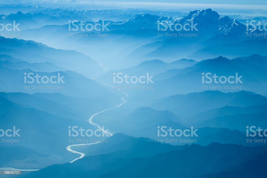 Aerial View of River Winding Through Foggy Himalyan Mountains - Royalty-free Aerial View Stock Photo