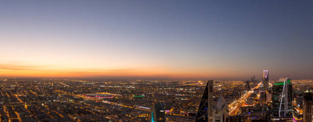 Aerial view of Riyadh City, the capital of Saudi Arabia Panoramic view of Riyadh city at sunset while lights start turning on saudi arabia stock pictures, royalty-free photos & images
