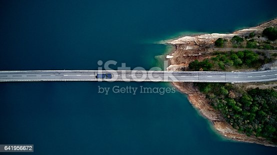 istock Aerial View of road above a lake 641956672