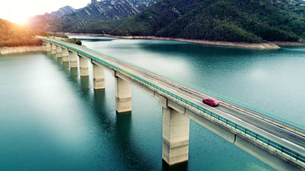 Aerial View of road above a lake stock photo