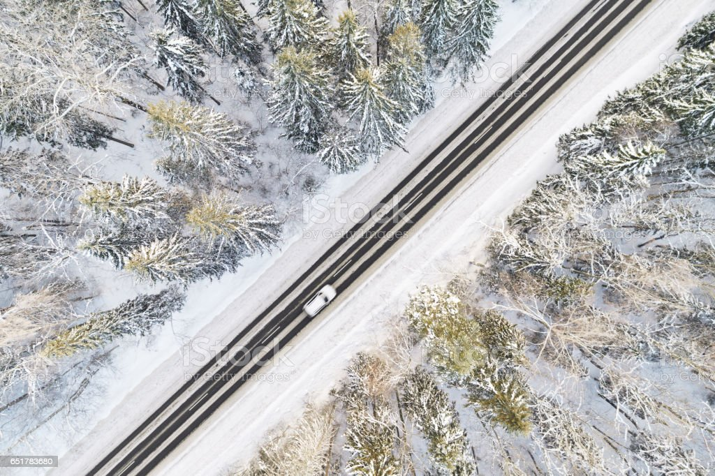 Aerial view of road in winter forest stock photo
