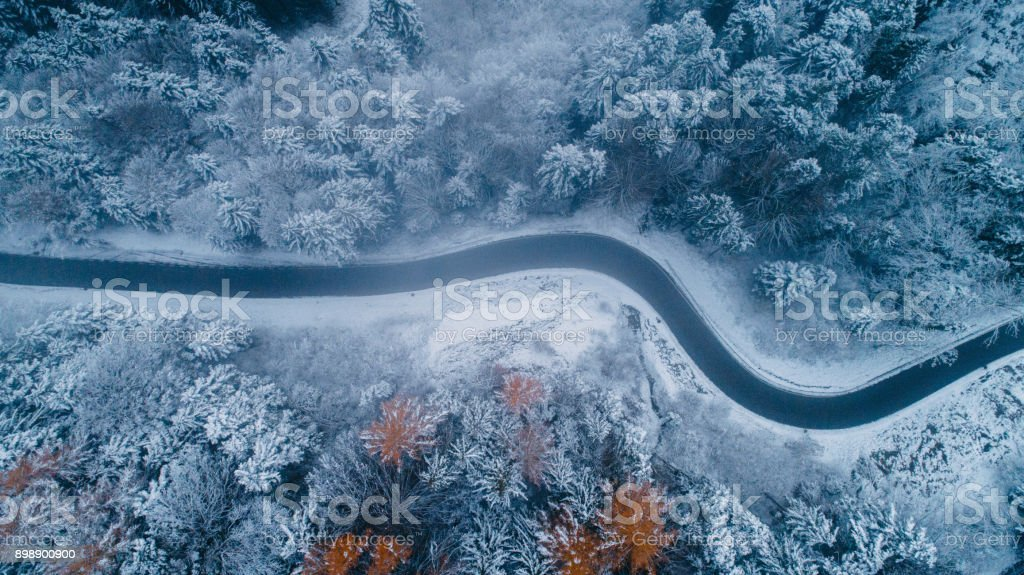 Aerial view of road in winter stock photo