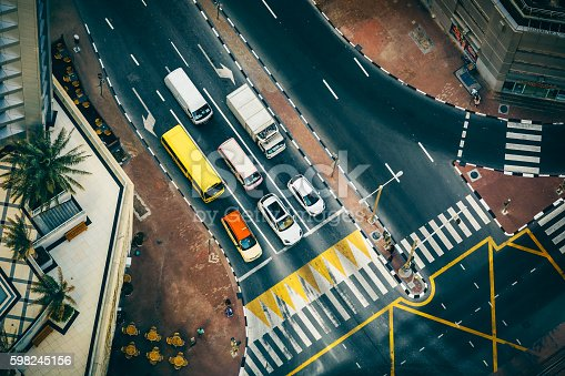 512697874 istock photo Aerial view of road intersection in Dubai Marina with traffic. 598245156