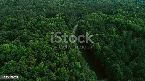 888361900 istock photo Aerial View of Road Through Forest in the Spring 1223456527