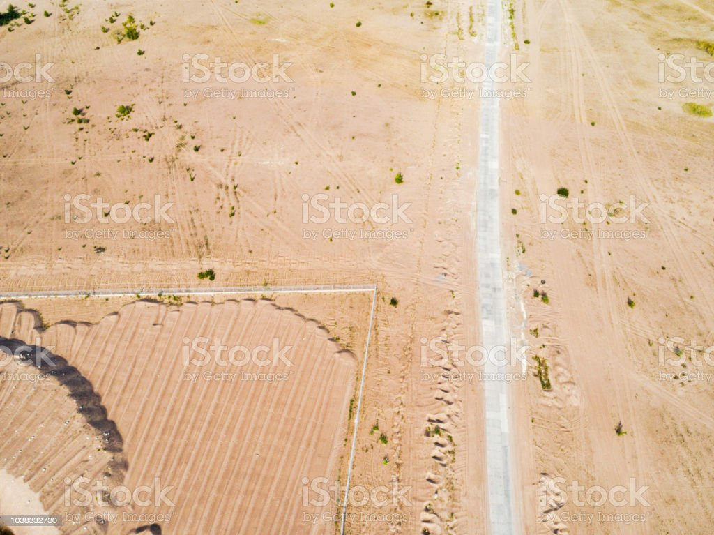 Aerial view of road with. Aerial view of a country road with sand....
