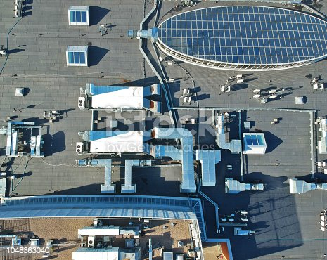 871063730istockphoto Aerial view of rooftop with all installations, electrical, ventilation and cooling. 1048363040
