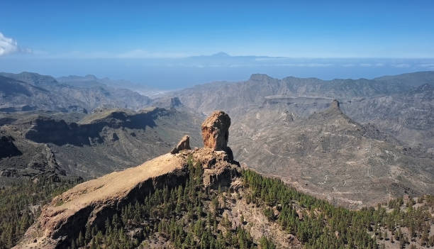 Aerial view of Roque Nublo, a volcanic rock in caldera of Tejeda, Gran Canaria, Canary islands, Spain. stock photo