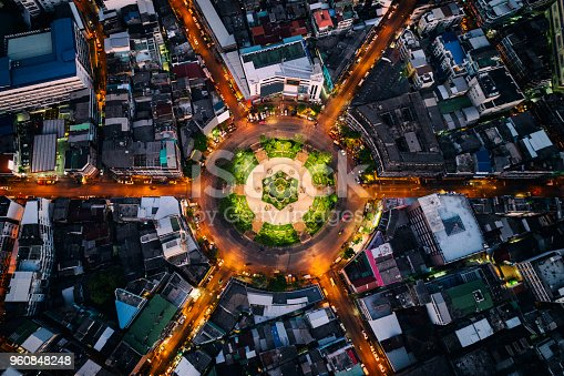 istock Aerial view of roundabout or circle of road with light trails on the road at night in Bangkok,Thailand. Expressway, Highway, Motorway, Tollway at Bangkok city downtown. 960848248