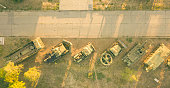 aerial view of row of military vehicles machines during sunset