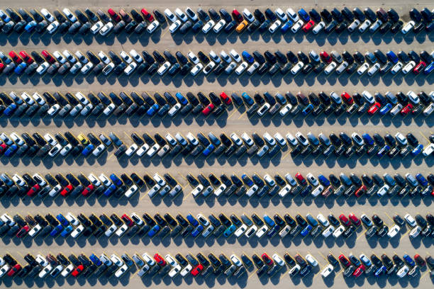 Aerial View of Rows of Cars Aerial view of new cars of different brands parked in rows on a lot. parking lot stock pictures, royalty-free photos & images