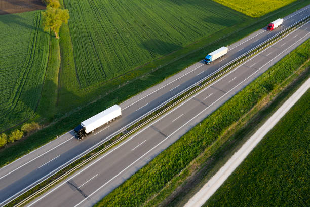 Aerial view of rural highway with semi trucks stock photo