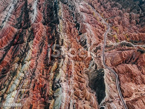 istock Aerial View of Rural Road through Danxia Landform 1318302815