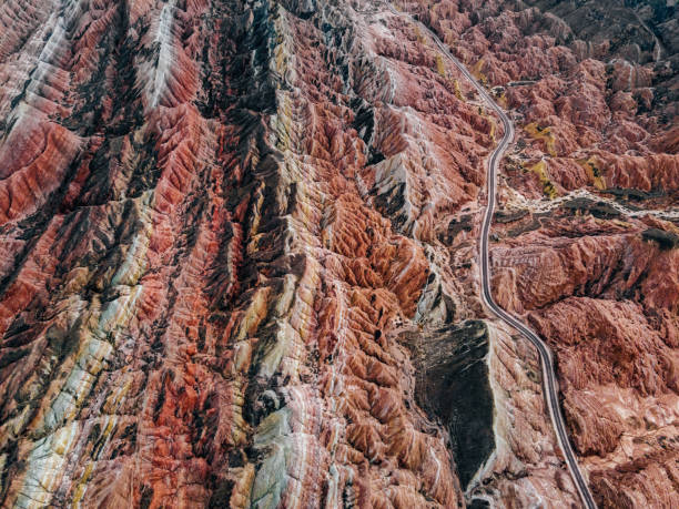 Aerial View of Rural Road through Danxia Landform Aerial View of Rural Road through Danxia Landform Zhangye Danxia Landform ,China stock pictures, royalty-free photos & images
