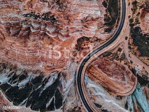 istock Aerial View of Rural Road through Danxia Landform 1318302821