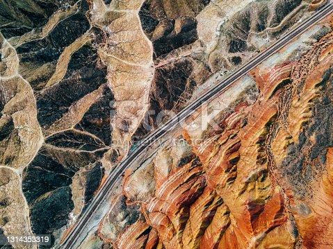 istock Aerial View of Rural Road through through Danxia Landform 1314353319