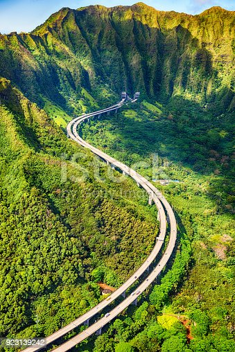 Highway H-3, the main artery between Kaneohe and Honlulu on Oahu, Hawaii shot from an altitude of about 1000 feet over the Pacific Ocean.