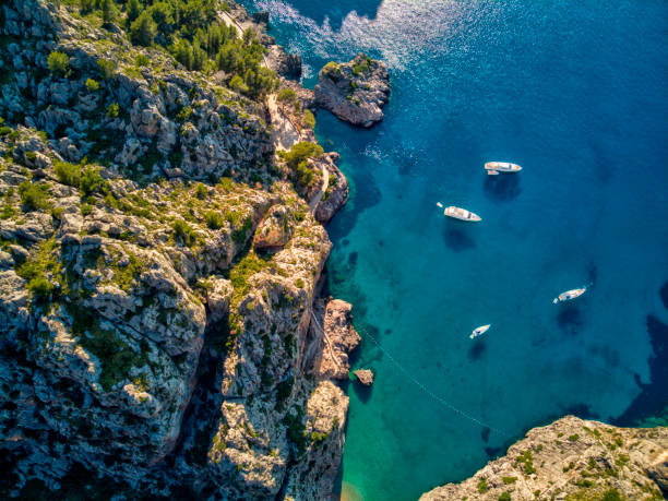 aerial view of sa calobra beach in mallorca - bay of water stock pictures, royalty-free photos & images