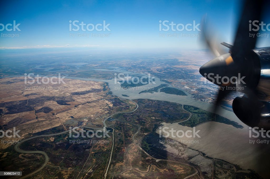 Aerial view of Sacramento River Delta through airplane window stock photo