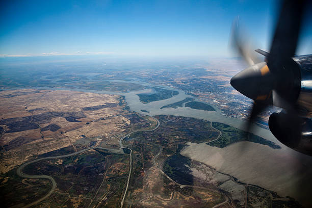 Aerial view of Sacramento River Delta through airplane window Small propeller engine airplane in flight over Sacramento-San Joaquin River Delta near San Francisco Bay, California. san francisco bay stock pictures, royalty-free photos & images