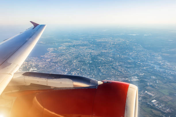 Aerial view of Saint-Petersburg, Russia, from an airplane with wing in front, travel concept. stock photo