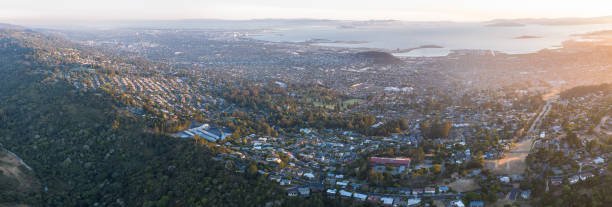Aerial View of San Francisco Bay Area Evening light illuminates the San Francisco Bay area in northern California. This beautiful area is heavily populated and is one of the west coast's most popular destinations. san francisco bay stock pictures, royalty-free photos & images