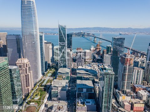 An aerial view of San Francisco skyline looking at Rincon Hill and the Salesforce Park. View includes a view of the 80 freeway, Bay Bridge and  San Francisco Bay.