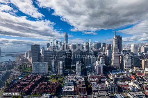 Aerial view of San Francisco skyline. Dramatic clouds over the Financial District with famous buildings on the horizon.