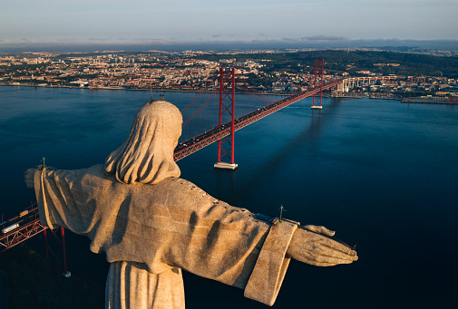 Aerial view of Sanctuary of Christ the King, Santuario de Cristo Rei. Drone photo at sunrise. Sightseeing in Portugal, Lisbon. High quality photo