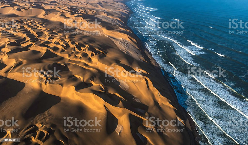 Aerial View of Sand Dunes and Ocean stock photo