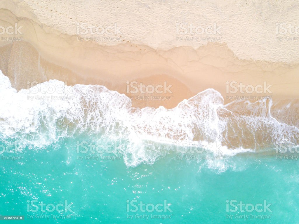Aerial view of sandy beach and ocean with waves stock photo