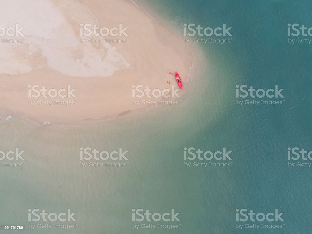Aerial View of Sandy Beach with kayak boat with Blue Sea royalty-free stock photo