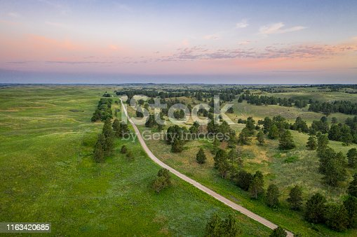 dawn over sandy road in Nebraska National Forest, aerial view