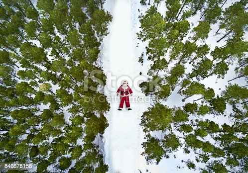 Aerial view of Santa Claus lying on the snow