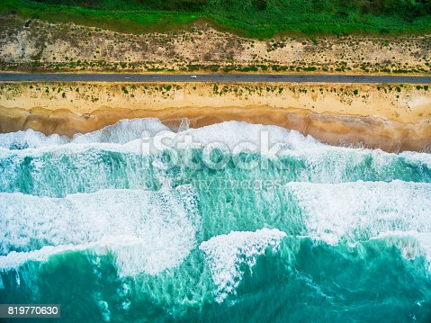 istock Aerial view of sea waves and beach 819770630