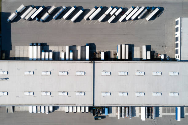 Aerial View of  Semi Trucks and Distribution Warehouse stock photo
