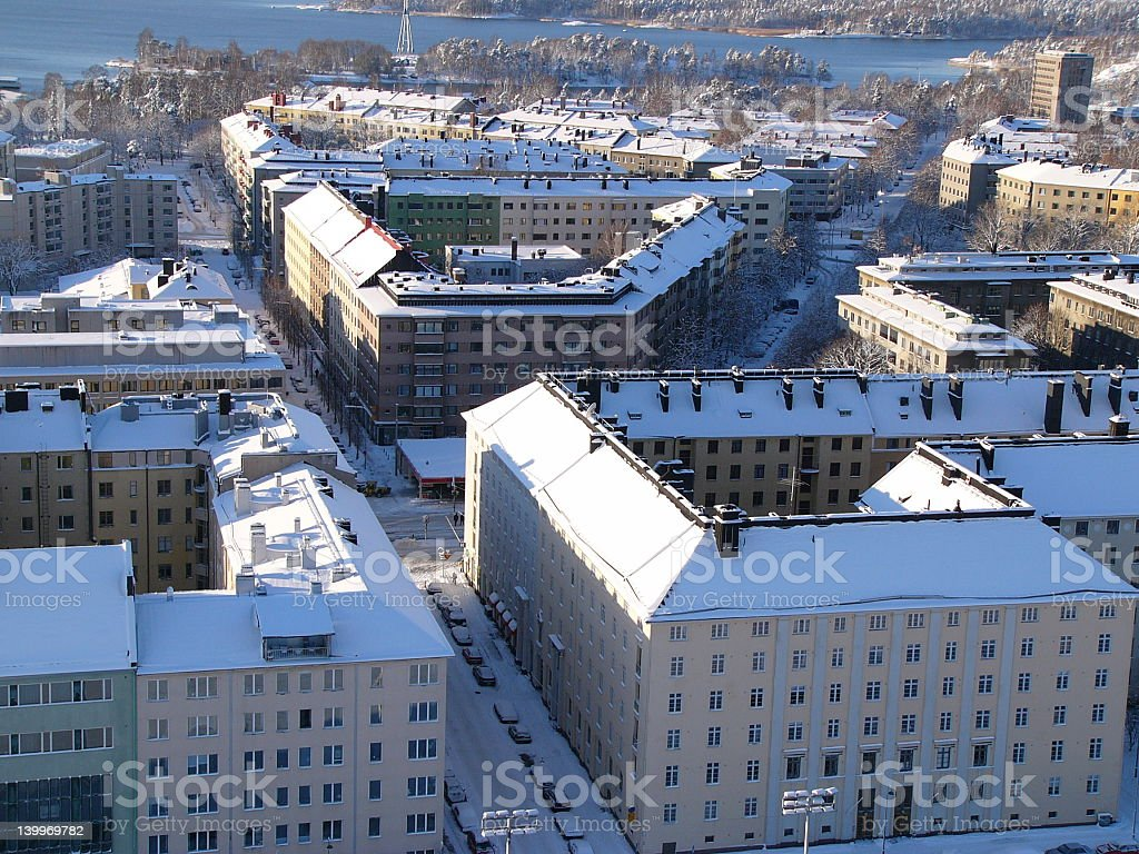 Aerial view of several apartment buildings covered in snow stock photo