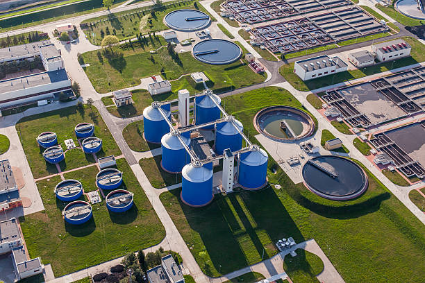 aerial view of sewage treatment plant aerial view of sewage treatment plant in wroclaw city in Poland sewage treatment plant stock pictures, royalty-free photos & images
