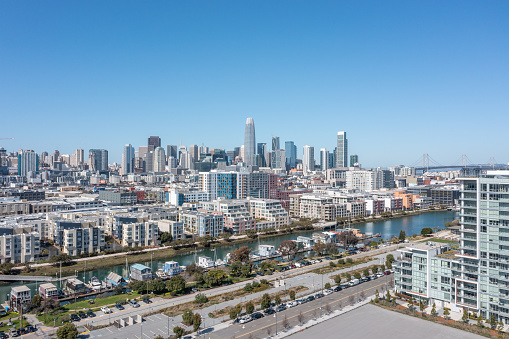 Aerial view of the San francisco skyline behind the houseboats on Mission Creek Channel.