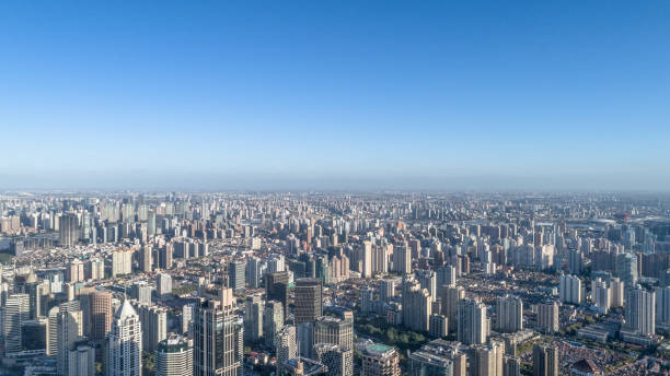 aerial view of shanghai city in a sunny day. nov 9, 2017 shanghai, china. - urban sprawl stock photos and pictures