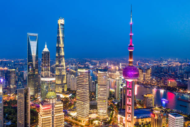 Aerial view of Shanghai city skyline at dusk View of the splendid aerial night view of downtown, Shanghai.drone point of view. huangpu district stock pictures, royalty-free photos & images