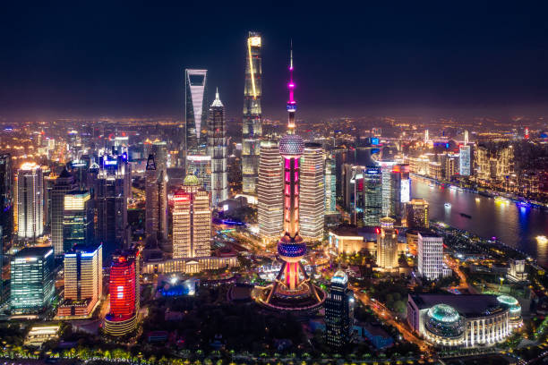 Aerial view of Shanghai city skyline at night View of the splendid aerial night view of downtown, Shanghai. huangpu river stock pictures, royalty-free photos & images