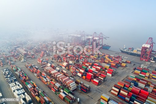 aerial view of shanghai container terminal in morning mist, China