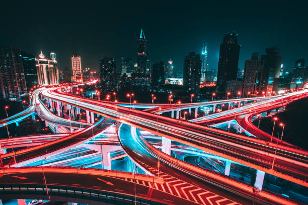 Aerial view of Shanghai Elevated Highway Aerial view of road intersection in Shanghai at night, with blurred motion long exposure stock pictures, royalty-free photos & images
