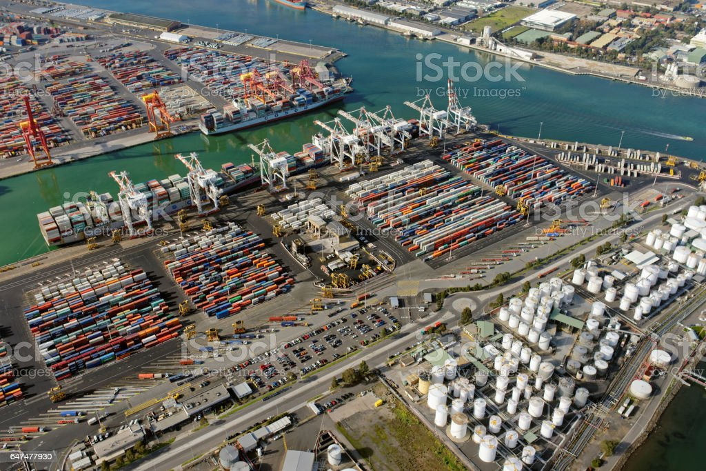 Aerial view of shipping containers, cranes and storage tanks in Melbourne, Australia stock photo