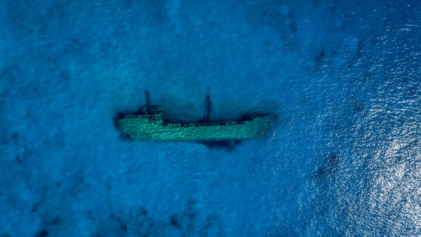 Aerial view of shipwreck underwater Shipwreck lying on the bottom of shallow sea water on south Peloponnese. View from above made with drone. sunken stock pictures, royalty-free photos & images