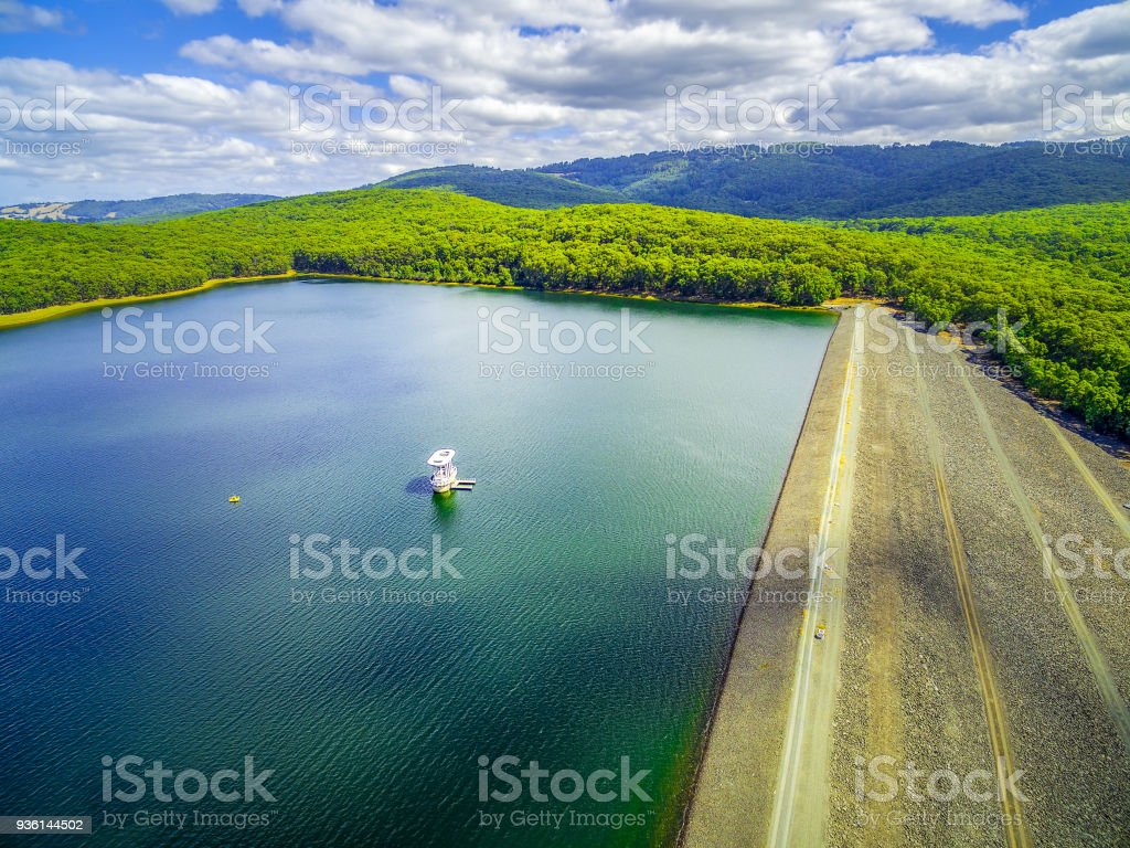 Aerial view of Silvan Reservoir lake dam wall and green hills. Melbourne, Australia stock photo