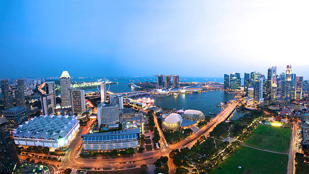 Aerial view of Singapore Skyline Extreme wide angle photo of Singapore Skyline at dusk. Suntec to the left, Esplanade theatre and Marina bay in the middle. Boat Quay and Financial district to the right. esplanade theater stock pictures, royalty-free photos & images