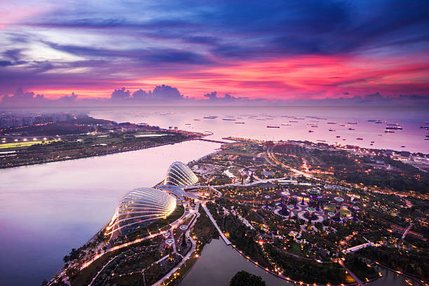 aerial view of singapore with sunset - singapore stock photos and pictures