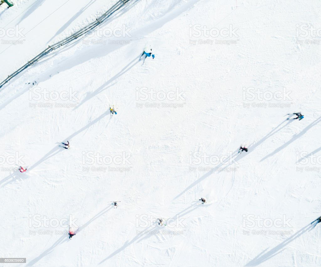 Aerial view of skiers stock photo