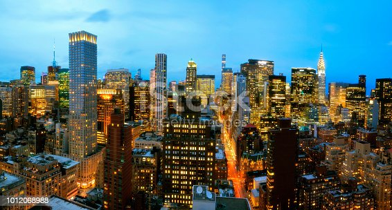istock Aerial View of Skyline in Manhattan at Dusk, New York City 1012068988